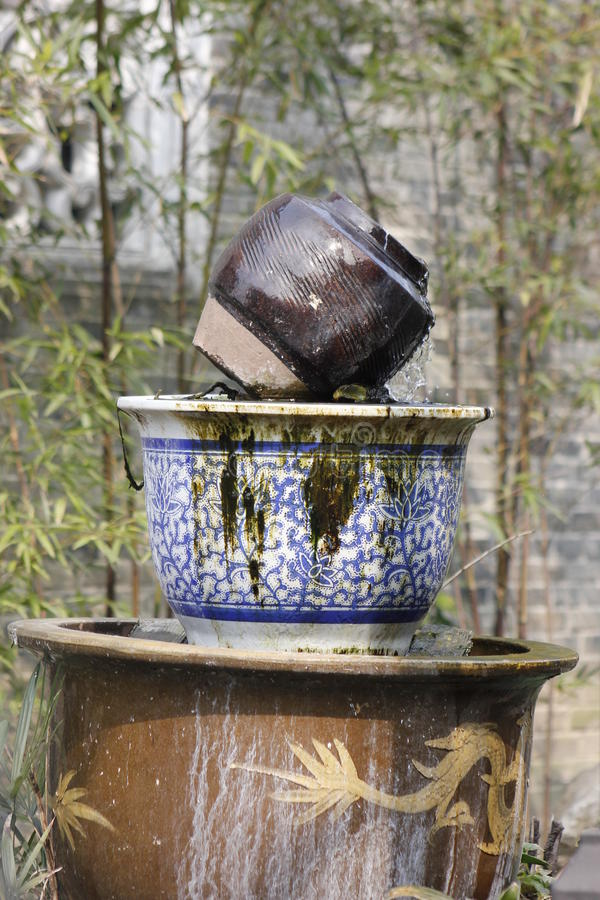 Pottery bottle coming out water as the spring stock photos