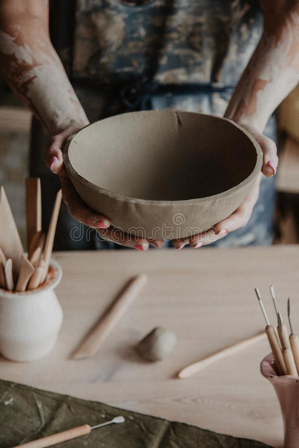 Free Pottery, Clay, Ceramics Art Concept - Closeup On Hands Of Young Master With The Large Plate From Fireclay Royalty Free Stock Photo - 137426875