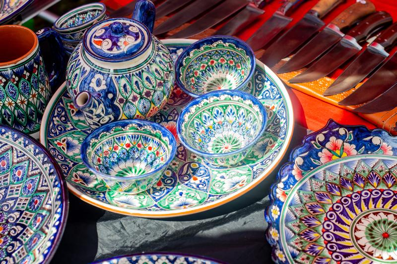 Pottery of colorful hand painted ceramic bowls and plates royalty free stock photo