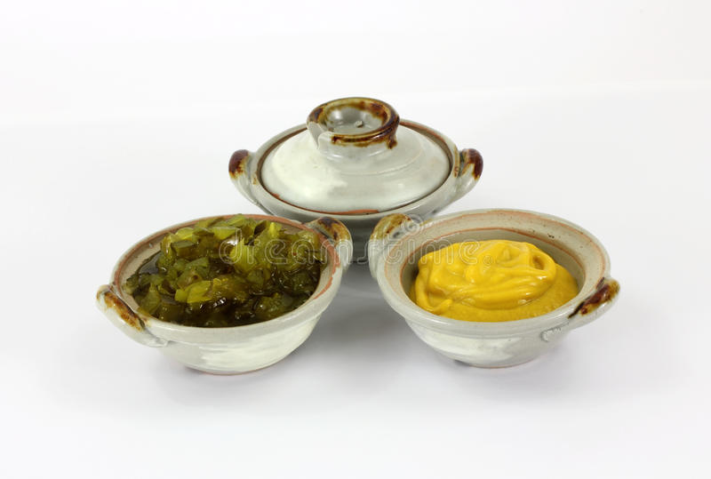 Pottery Dishes Mustard Relish royalty free stock photo
