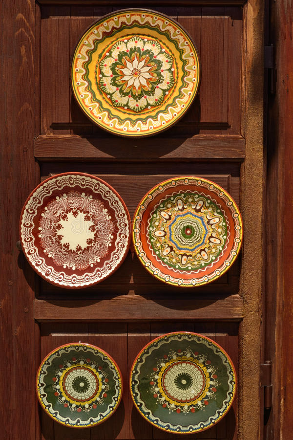 Pottery dishes in oriental style at wooden stand royalty free stock photography