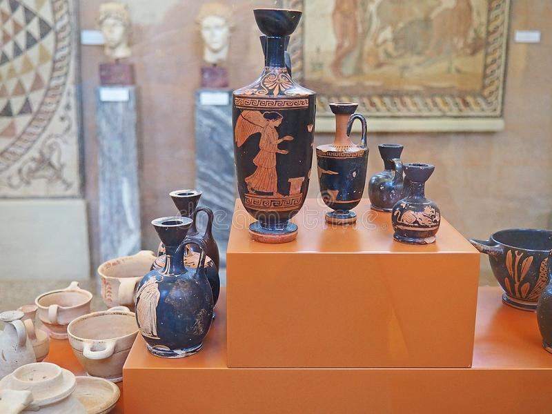 Geometric pottery in the Archaeological Museum of Ancient Corinth, Greece. Pottery display in the Archaeological Museum of Ancient Corinth in Greece royalty free stock photo