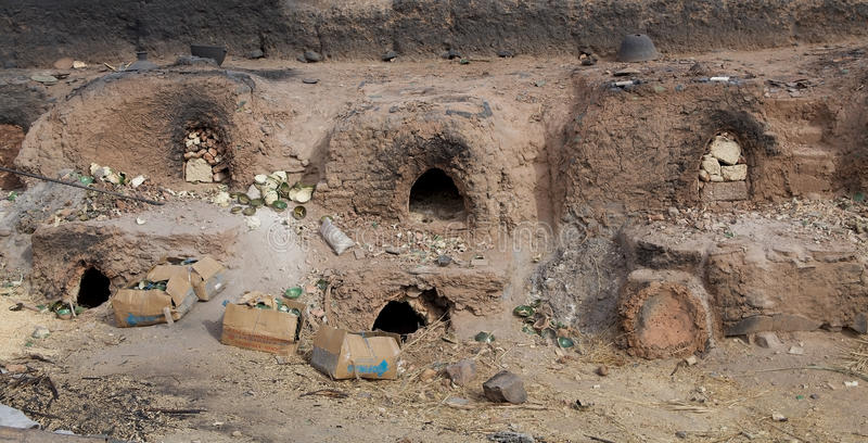 Pottery factory. Tamegroute, Morocco:kilns at the pottery factory. A kiln is a thermally insulated chamber, or oven, in which a controlled temperature regime is royalty free stock photos
