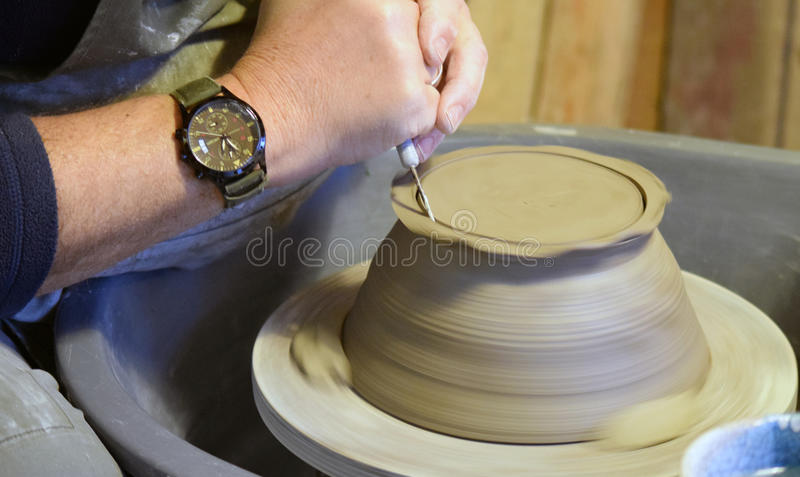 Pottery of Grizedale. Craftsman in Grizedale Forest visitors centre showing how to craft a pot. Cumbria royalty free stock photography