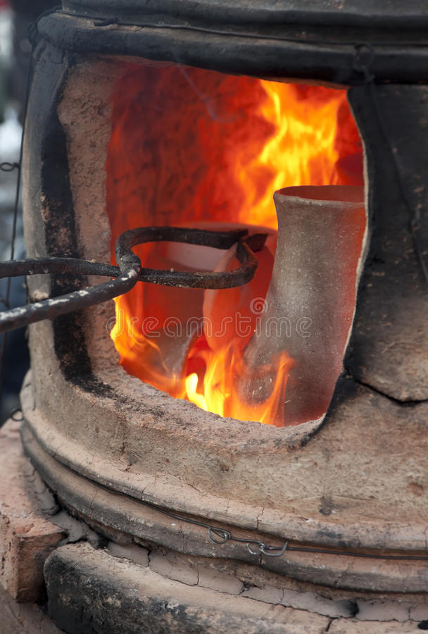 Pottery kiln. Old pottery kiln and pot stock image