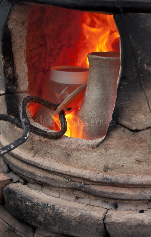 Pottery kiln. Old pottery kiln and pot royalty free stock photos