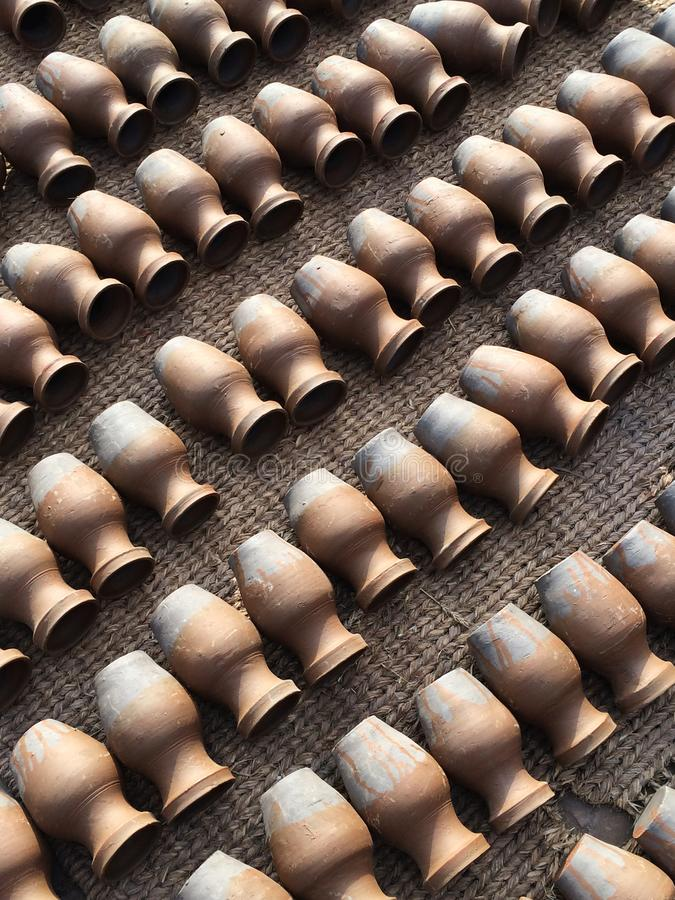 Pottery lying in diagonal lines. Concept of duplication, quality, craft. View from the top stock photography
