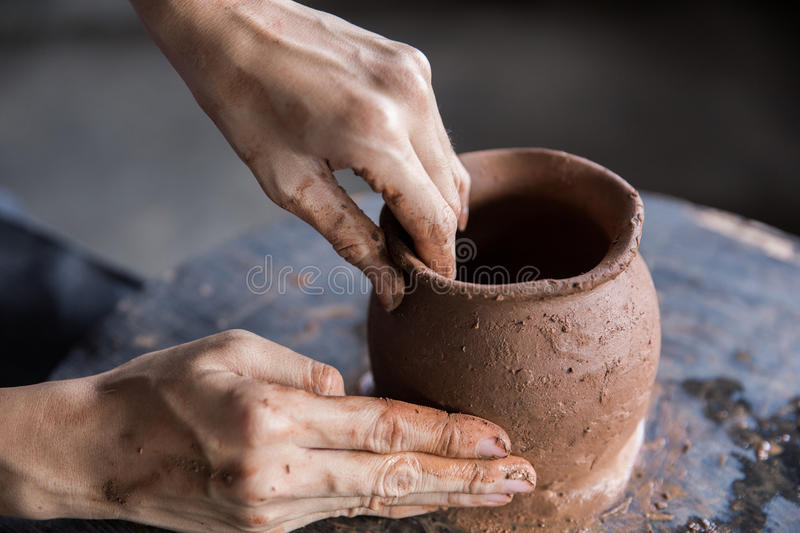 Pottery making. hand transforming clay close up stock images