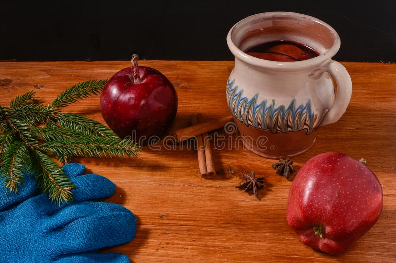 Red boiled wine on rustic wooden table royalty free stock photo