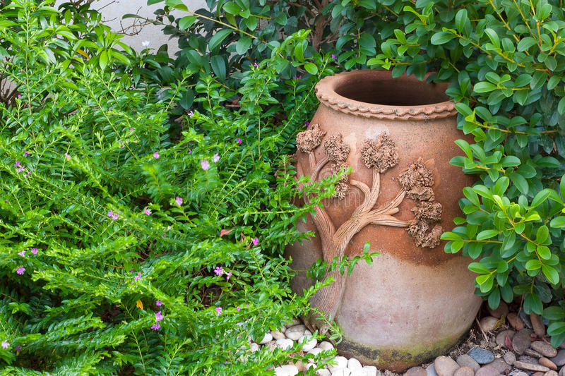 Pottery in the park. Pottery bowl with ornamental gardens royalty free stock photos