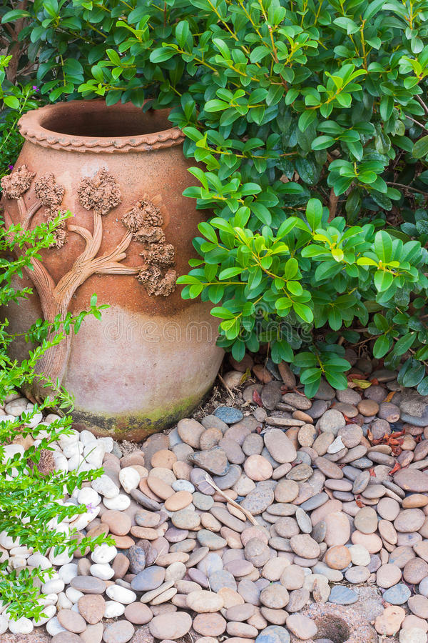 Pottery in the park. Pottery bowl with ornamental gardens stock photography