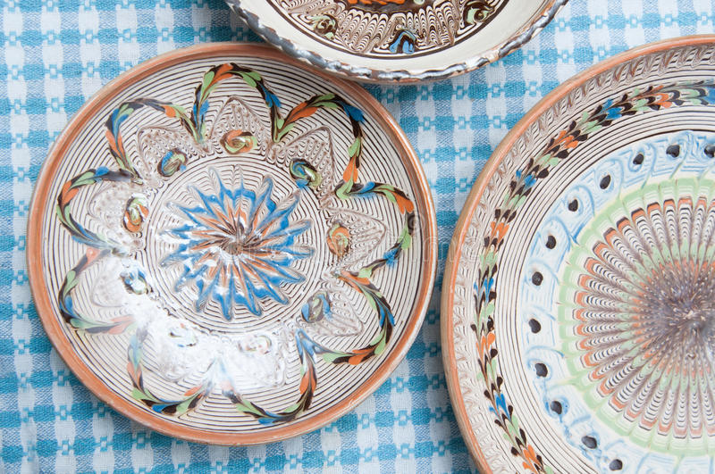 Pottery plates. On the table royalty free stock photo
