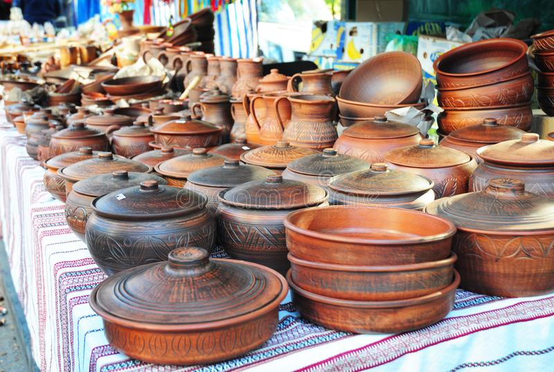 Pottery for sale. Traditional Ceramic Jugs. Handmade Ceramic Pottery in a Roadside Market with Ceramic Pots and Clay Plates. Outdoors royalty free stock images