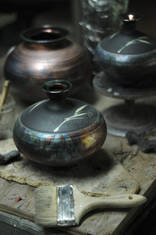 Pottery Shop. Several raku art pots inside of a pottery shop stock photos