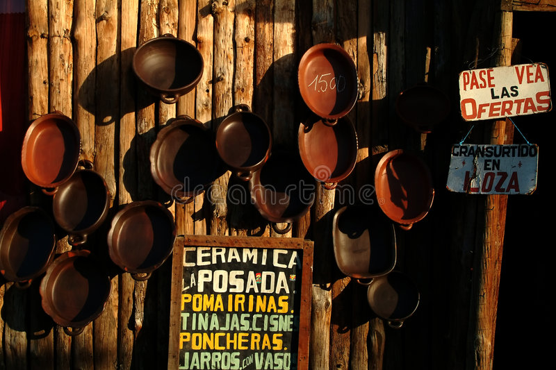 Pottery shop. Typical pottery shop from pomaire in chile with pottery dishes and signboard stock images