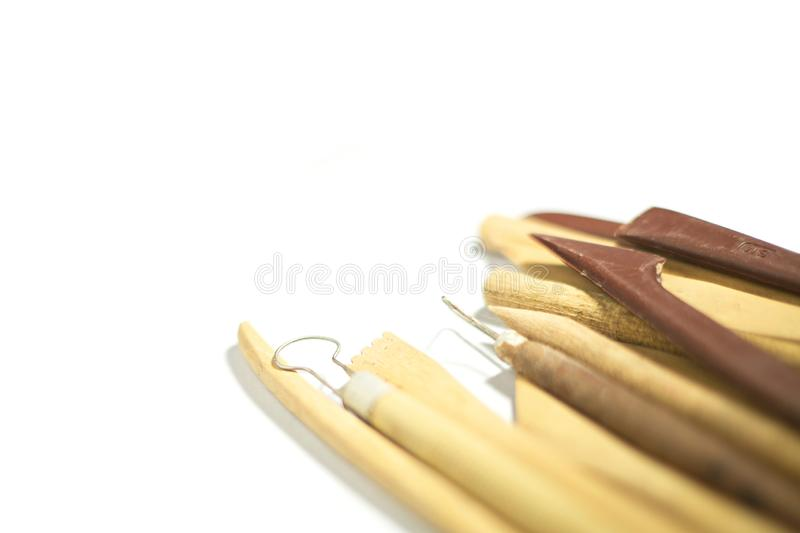 Pottery tools closeup isolated on white background, selective focus royalty free stock photography