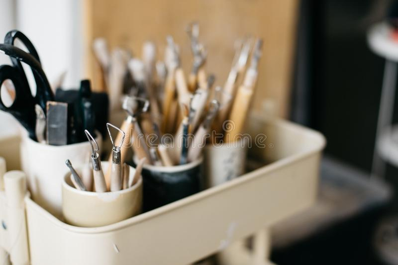 Pottery tools in studio stock images