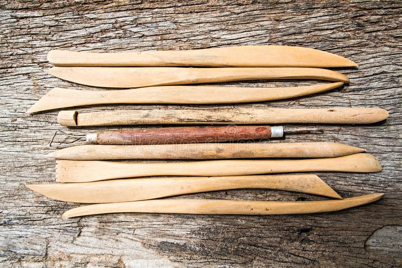 Pottery tools on wood background royalty free stock photography
