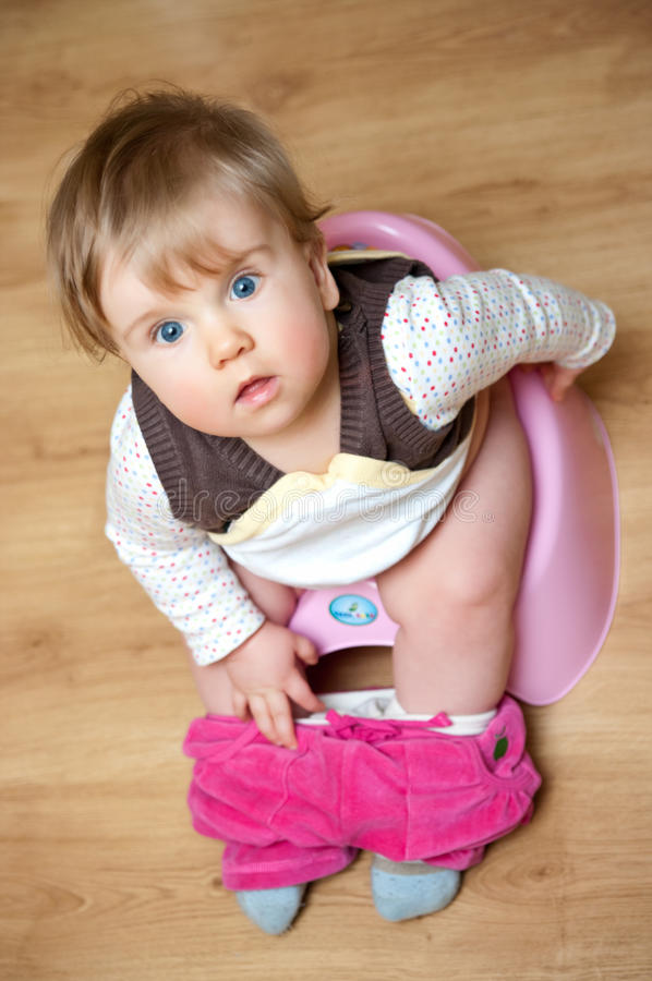 Potty Training. A young child learning how to use the potty royalty free stock images