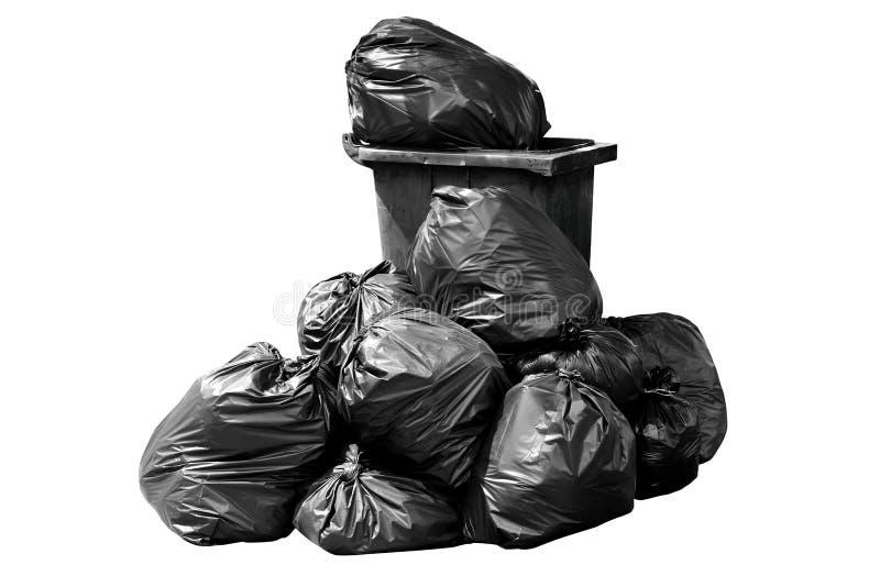 Poubelle, déchets, déchets, déchets, pile de sachets en plastique, noir foncé de déchets de sac de poubelle d'isolement sur le bl photo stock