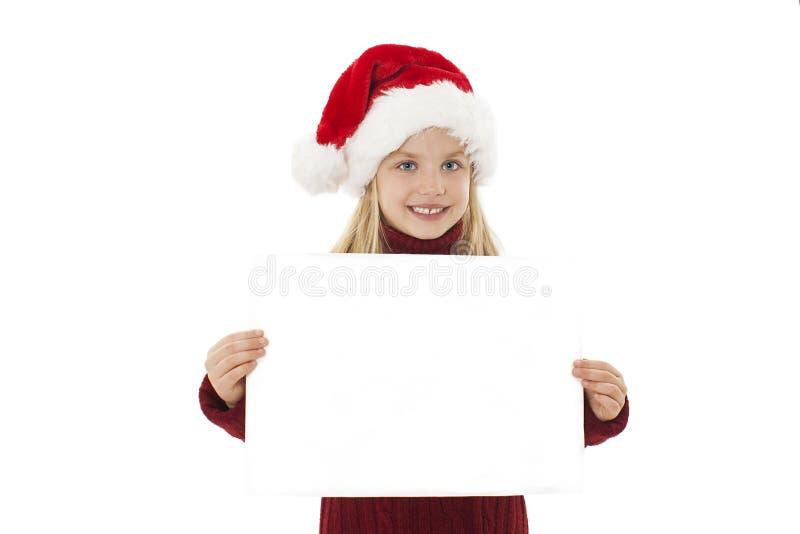 Pouca apresenta??o da menina do Natal Menina adorável que guarda o papel vazio imagem de stock royalty free