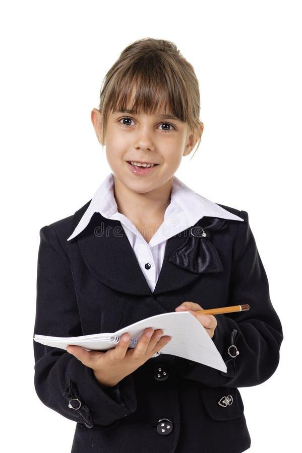 Pouca menina da escola no uniforme imagens de stock royalty free