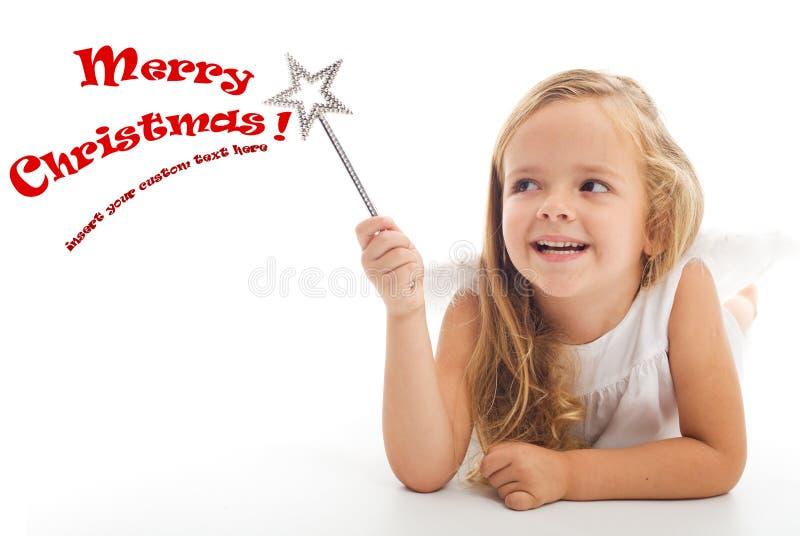 Pouca menina do feiticeiro do Natal fotografia de stock