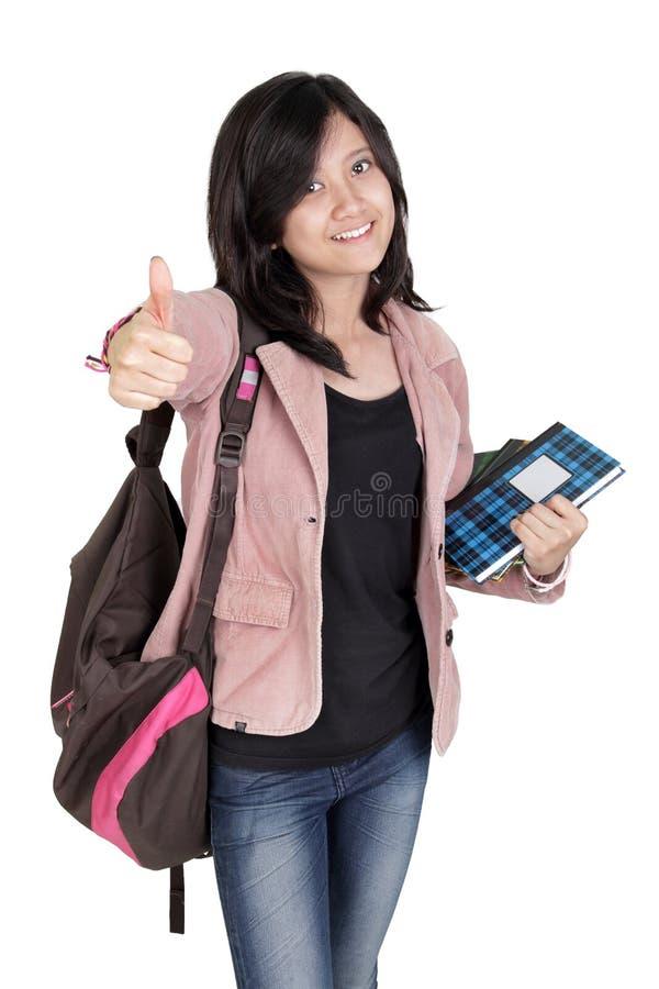 Pouce heureux d'étudiant vers le haut de portrait de gestes photos libres de droits
