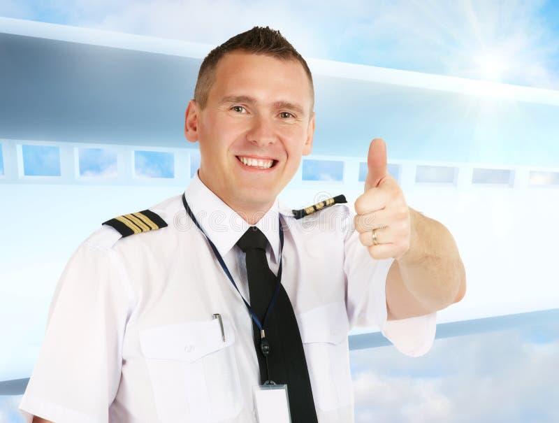 Pouce pilote de compagnie aérienne vers le haut images libres de droits