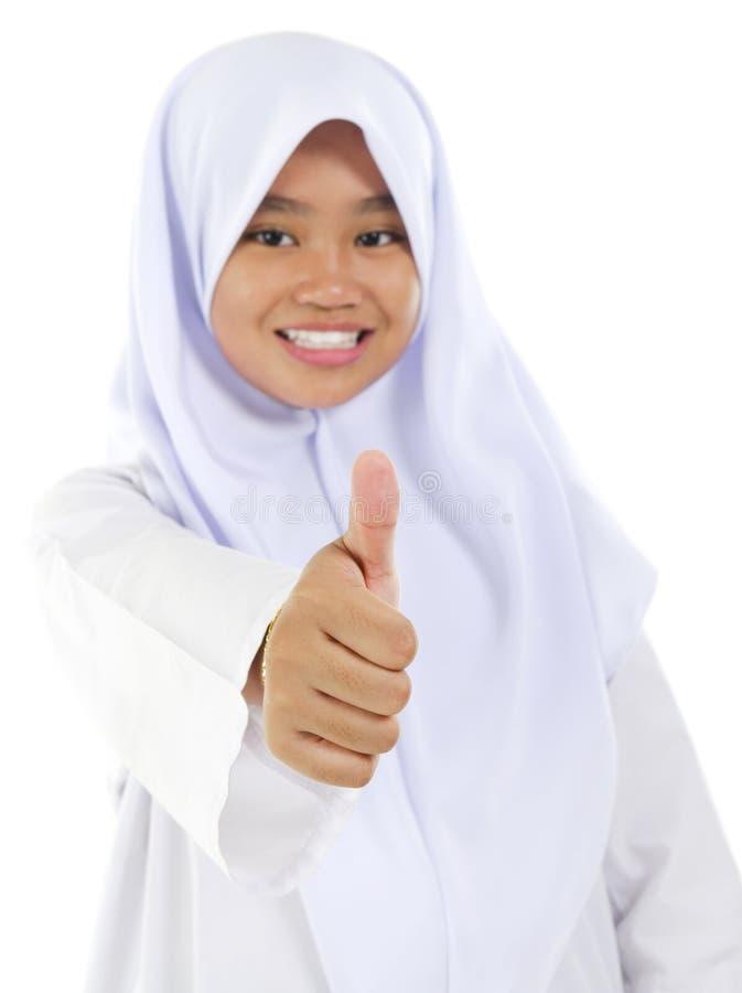 Pouce vers le haut de de l'adolescence musulman image libre de droits