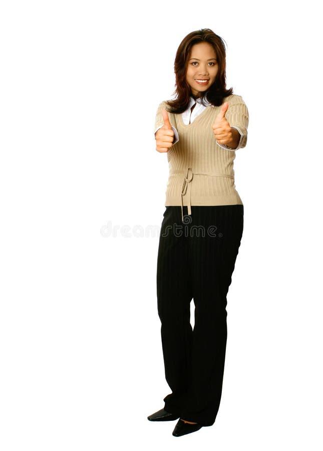 Pouces asiatiques de femme d'affaires vers le haut photographie stock