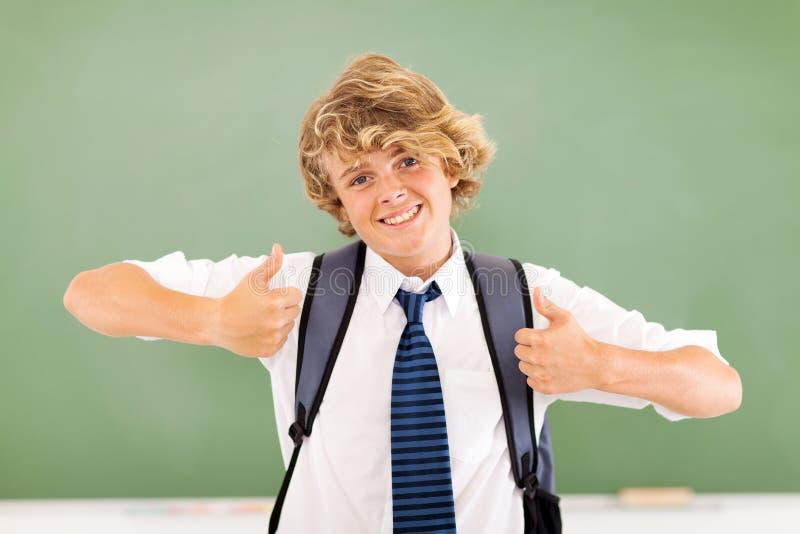 Pouces d'adolescent vers le haut photo libre de droits