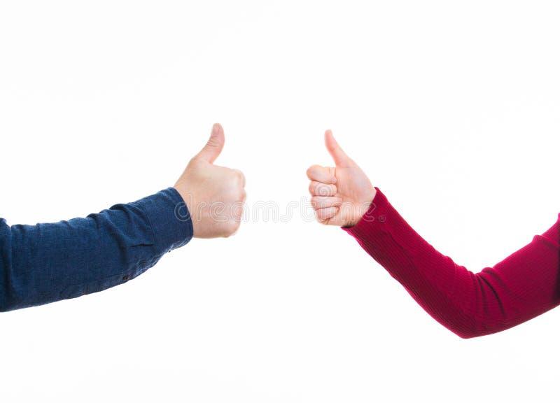 Pouces d'homme et de femme vers le haut de geste image libre de droits