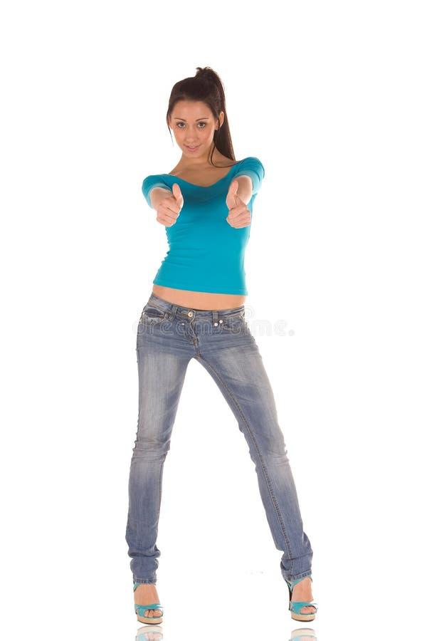 Pouces de jeune femme vers le haut photo libre de droits