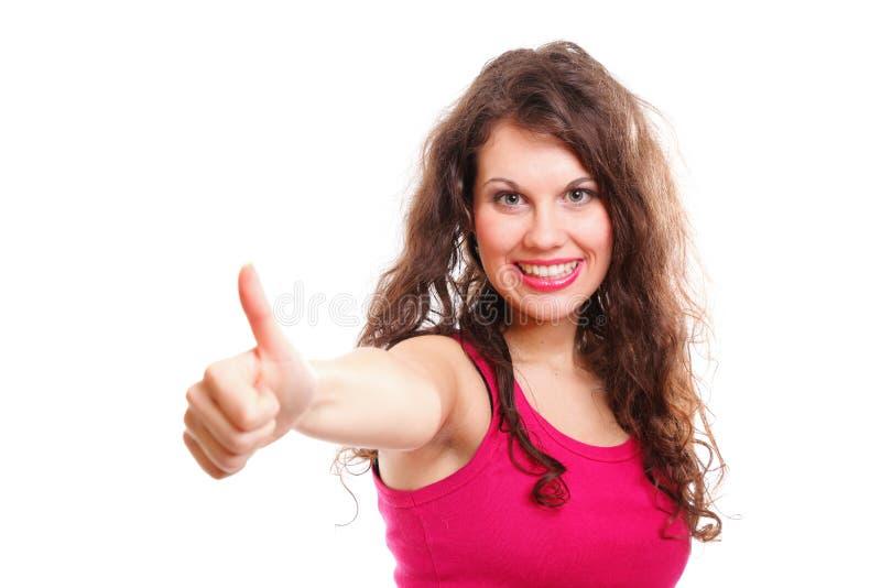 Pouces heureux de femme d'ajustement sportif  photographie stock libre de droits