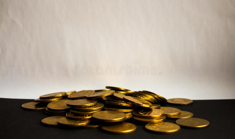 Pouch of gold coins on white background stock image