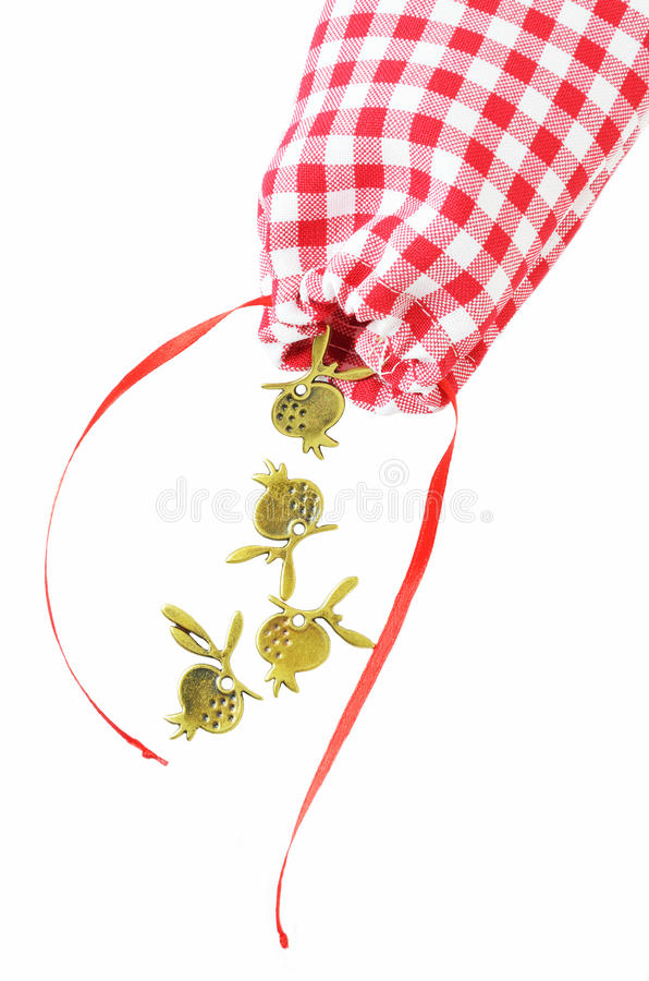 Pouch with pomegranates charms royalty free stock photos