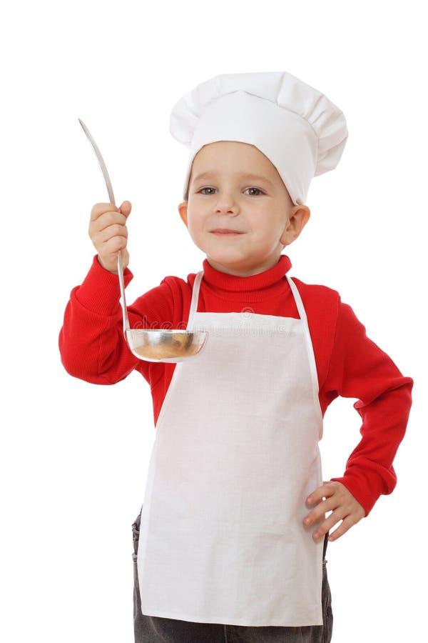 Pouco chefe-fogão de sorriso com concha foto de stock