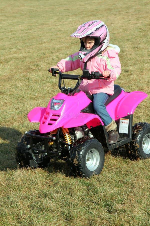 Pouco menina 1 do quadrilátero do veículo com rodas da cor-de-rosa quatro imagens de stock royalty free