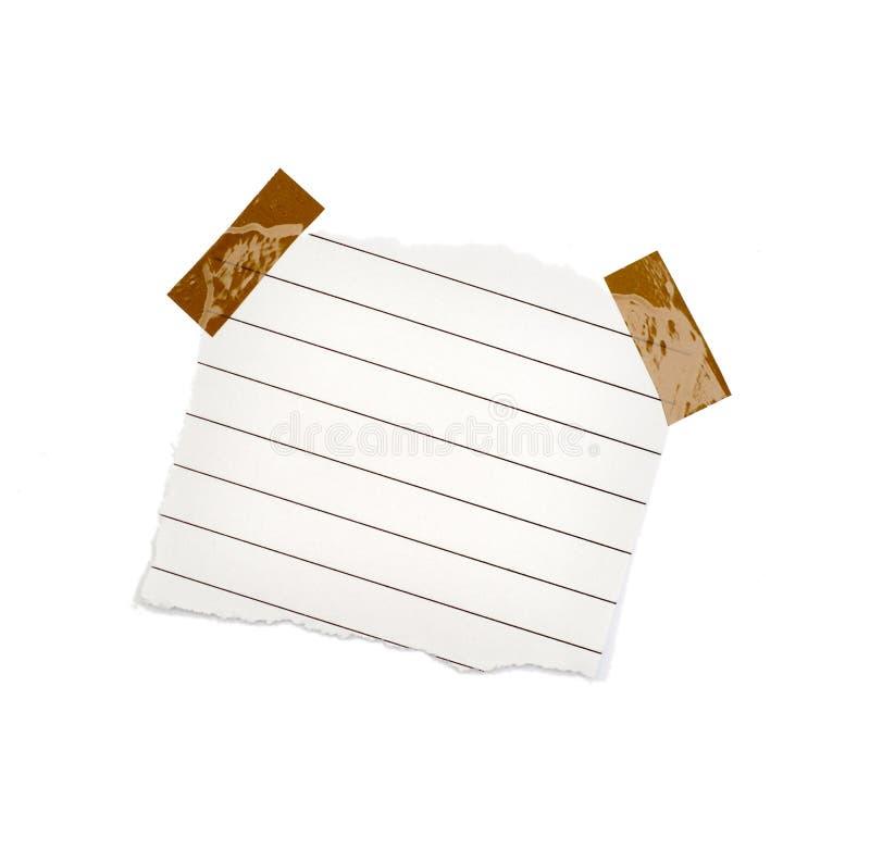 Pouco pedaço de papel guardarado por um adesivo fotos de stock