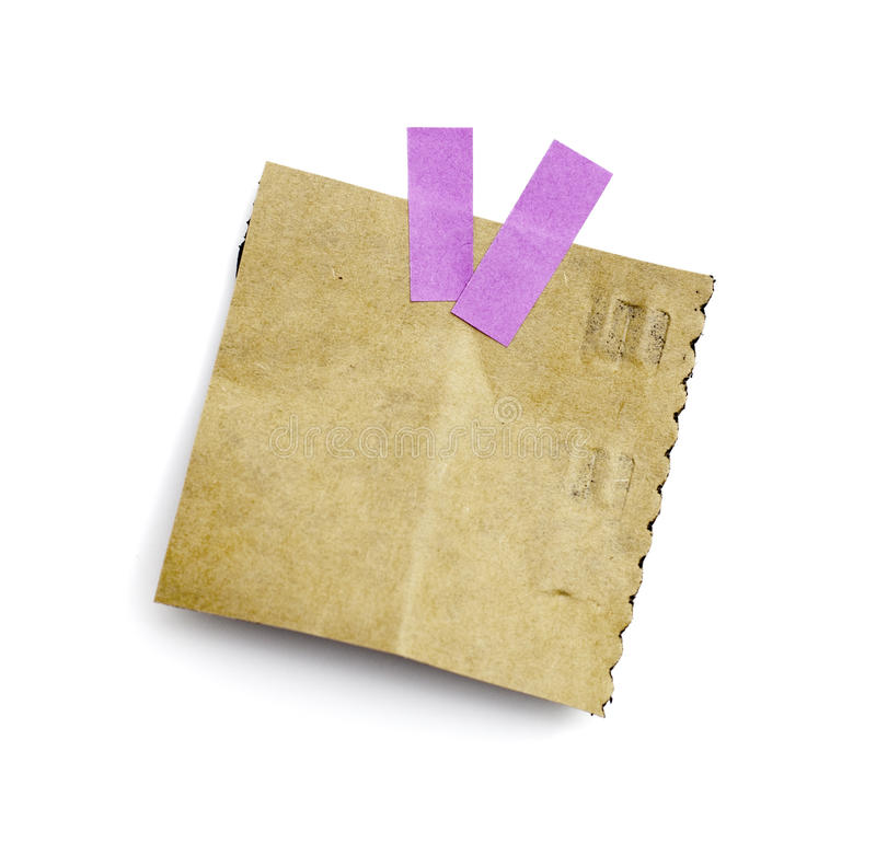 Pouco pedaço de papel guardarado por um adesivo imagens de stock