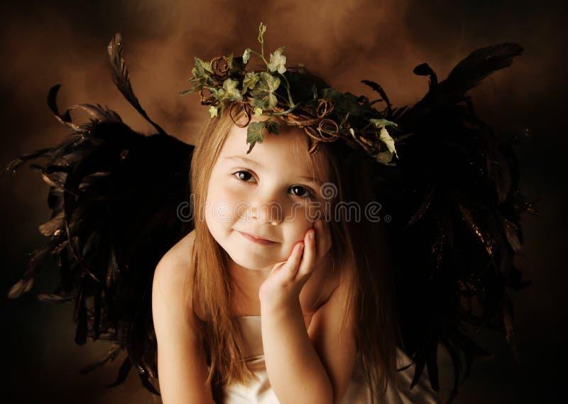 Poucos ouro e criança marrom do anjo foto de stock
