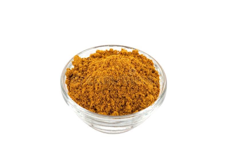 Poudre de cari chaude de Madras dans la cuvette en verre images stock