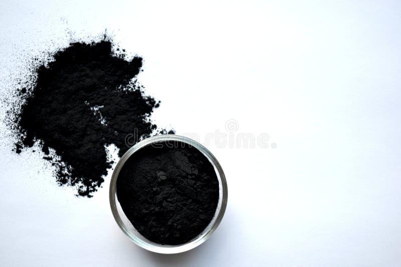 Poudre de charbon actif, plan rapproché photographie stock