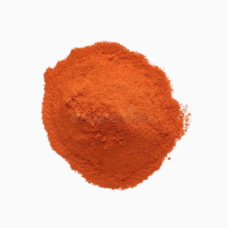 Poudre rouge de paprika d'isolement sur le fond blanc photos stock