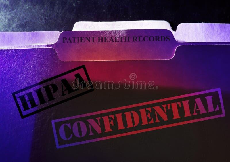 Poufne Cierpliwe dokumentacji medycznych HIPAA falcówki obraz royalty free