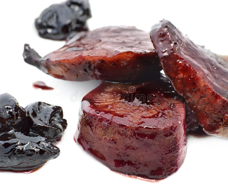 Poultry in sweet sauce with prunes royalty free stock photo