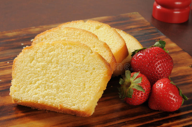 Pound cake and strawberries royalty free stock photo