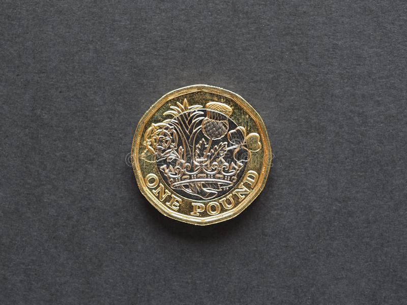 1 pound coin, United Kingdom. New 1 pound coin money (GBP), currency of United Kingdom royalty free stock image