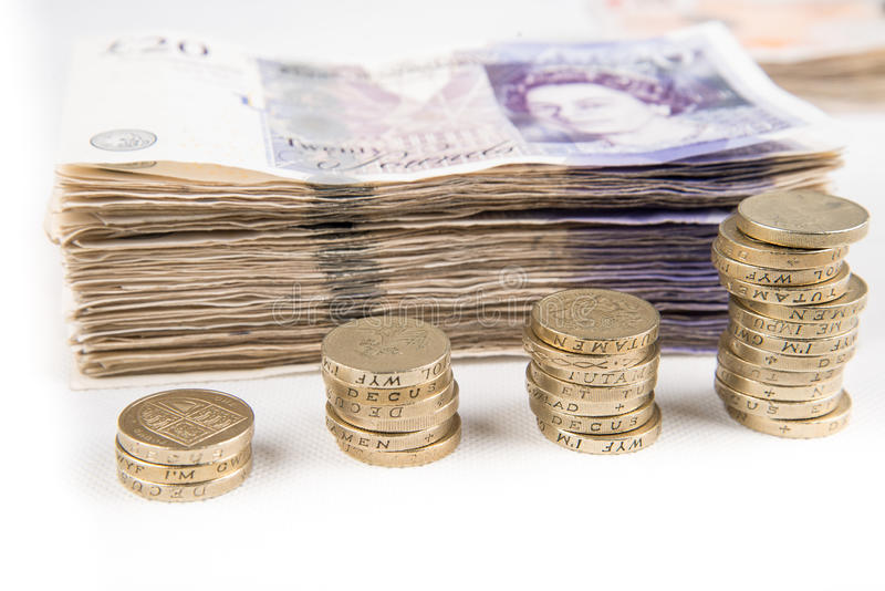 Pound notes and coins royalty free stock image